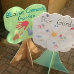 Garden signs decorated byy children visiting over the weekend